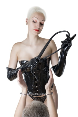 sexual dominatrix black leather lingerie with a whip